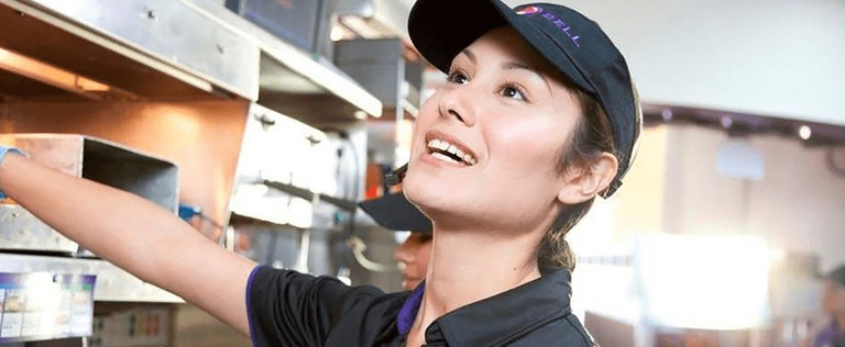 Taco Bell employee happy at work