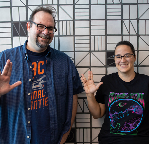 A couple Nextiva employees waving at the camera.